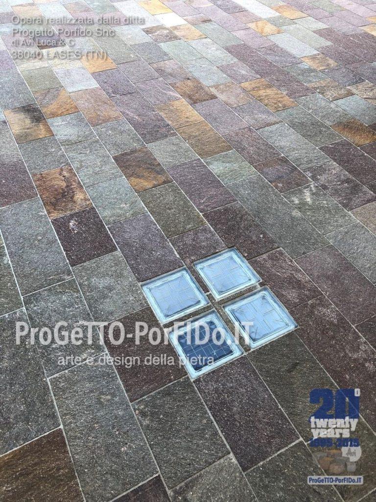 fornitura e posa pavimento piastre di porfido rosso